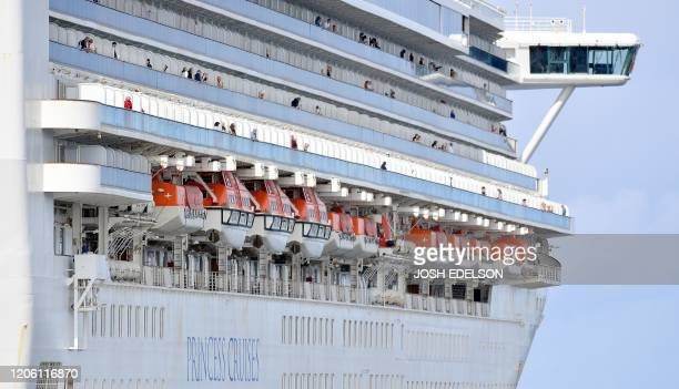 Passengers look out from aboard the Grand Princess cruise ship operated by Princess Cruises as it maintains a holding pattern about 25 miles off the...