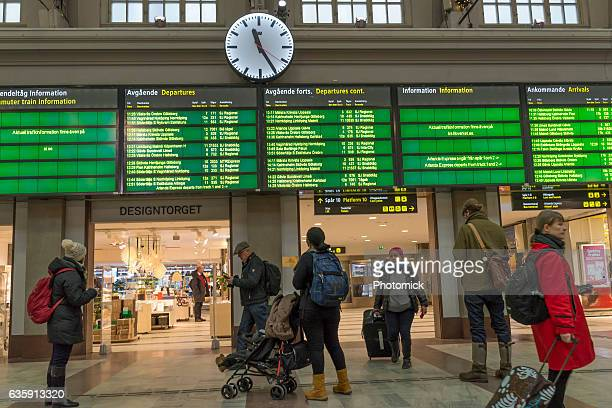 Passengers looking at train departure times at Stockholm's central station