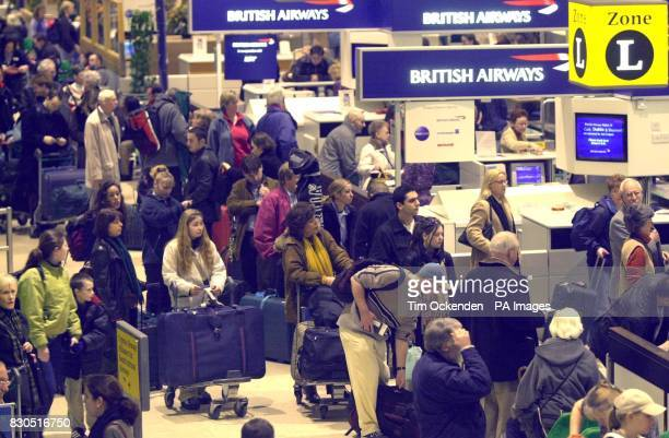 Passengers looking to get away for Christmas queue up at the CheckIn desks at Heathrow Airport 's Terminal 1 at the beginning of the Christmas rush...