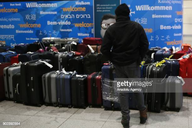 Passengers' luggage and passengers are seen during the weatherrelated cancellation at the John F Kennedy Airport in New York United States on January...