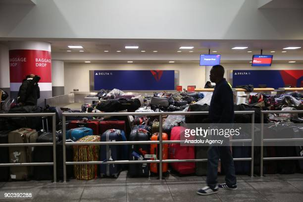 Passengers' luggage are seen during the weatherrelated cancellation at the John F Kennedy Airport in New York United States on January 08 2017...