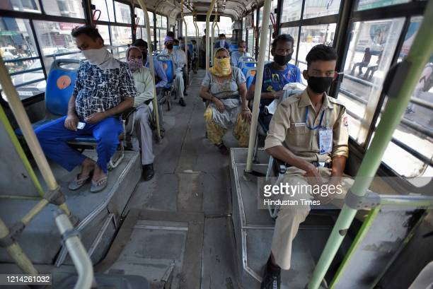 Passengers maintaining social distance as they are on board in a DTC Bus after government eased lockdown restriction at AIIMS on May 20 2020 in New...