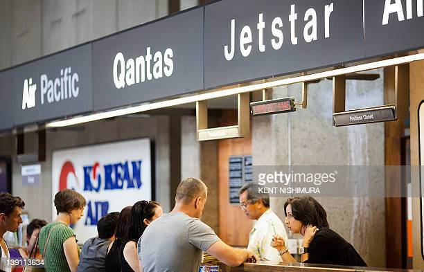 Passengers make arrangements for flights at the Quantas and Jetstar ticket counter at Honolulu International Airport on Thursday February 16 2012 in...