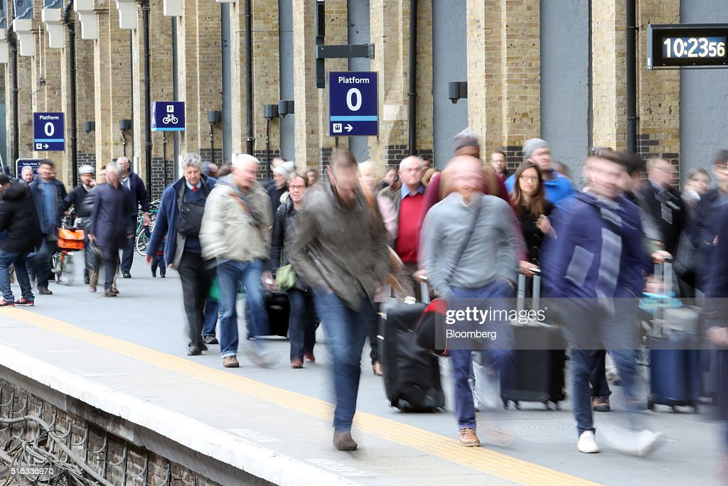 Passengers make their way along a platform at Kings Cross station, in London, U.K., on Friday, March 18, 2016. Virgin Trains will revive plans to offer high-speed Internet access on Europes busiest rail route in a bid to beat the plane and persuade business people to travel outside peak hours. Photographer: Chris Ratcliffe/Bloomberg via Getty Images