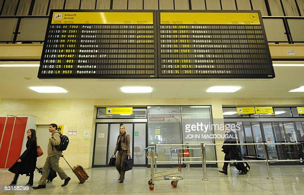 Passengers make their way into the main terminal at Tempelhof airport in Berlin October 7, 2008. The airport, originally built in 1923, was...