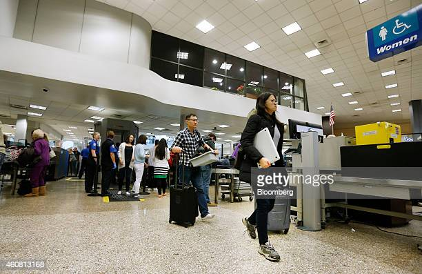 Passengers make their way through a Transportation Security Administration check point at Salt Lake City International Airport in Salt Lake City Utah...