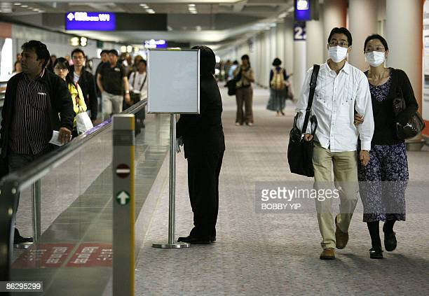 Passengers make their way to immigration at the Hong Kong Airport ask passengers to fill in health declaration forms on arrival in Hong Kong on April...