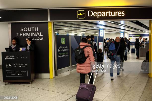 Passengers make their way to the departure gate at London Gatwick Airport after flights resumed today on December 21, 2018 in London, England....