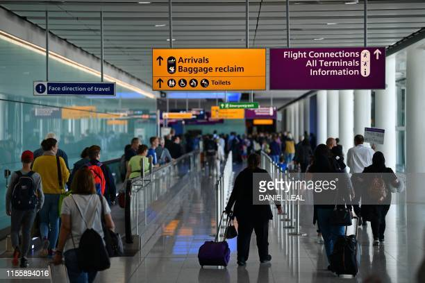 Passengers make their way towards the Baggage reclaim and flight connections in Terminal 2 having arrived at Heathrow Airport in London on July 16...
