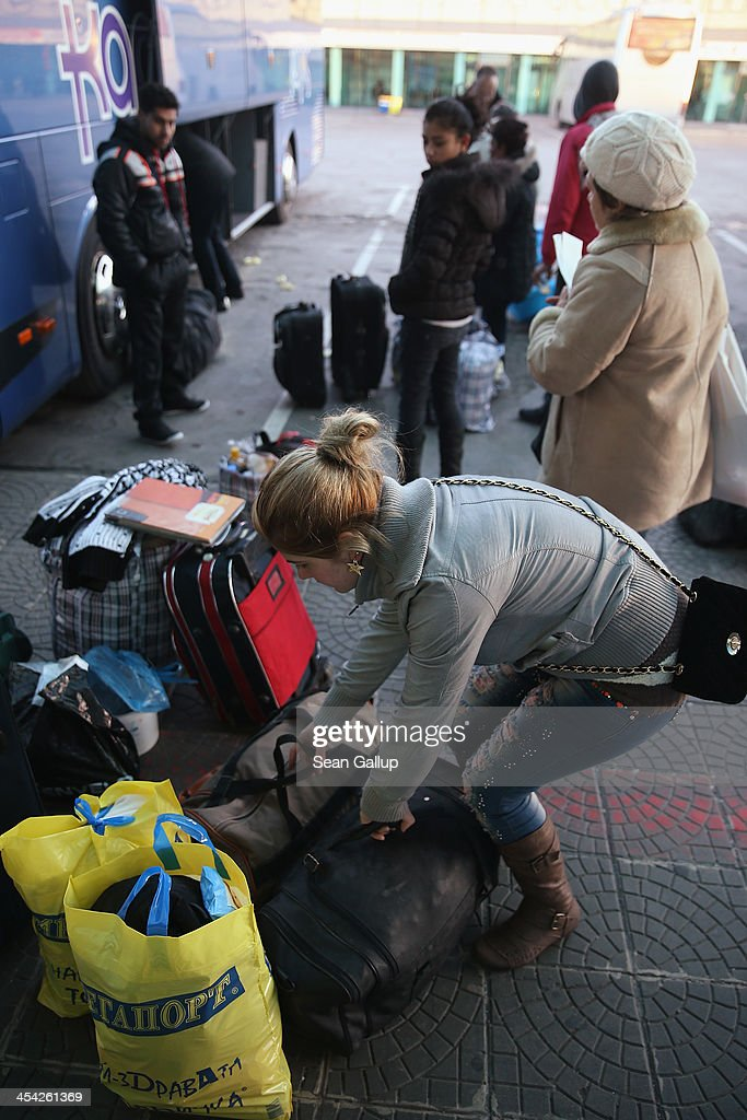 Passengers, mostly ethnic Roma, prepare to board a bus destined for cities in Germany, including Munich, Frankfurt and Dortmund, at the main bus station on December 8, 2013 in Sofia, Bulgaria. Restrictions on the freedom of Bulgarians and Romanians to work in the European Union are due to run out by December 31, though several EU leaders, including British Prime Minister David Cameron, are considering imposing temporary restrictions to cut the flow of Romanians and Bulgarians arriving in EU countries. Many EU nations have voiced concern over too many Bulgarians and Romanians arriving and applying for social benefits. Romania and Bulgaria are both EU members though their citizens do not yet receive the same rights as citizens of other EU nations.