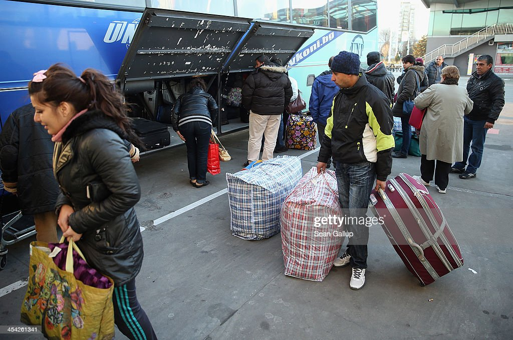 Passengers, mostly ethnic Roma, retrieve their luggage after descending from a bus that had arrived from Spain and France at the main bus station on December 8, 2013 in Sofia, Bulgaria. Restrictions on the freedom of Bulgarians and Romanians to work in the European Union are due to run out by December 31, though several EU leaders, including British Prime Minister David Cameron, are considering imposing temporary restrictions to cut the flow of Romanians and Bulgarians arriving in EU countries. Many EU nations have voiced concern over too many Bulgarians and Romanians arriving and applying for social benefits. Romania and Bulgaria are both EU members though their citizens do not yet receive the same rights as citizens of other EU nations.