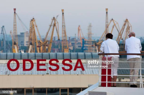 Passengers of a cruise ship look out at the port of Odessa, Ukraine.