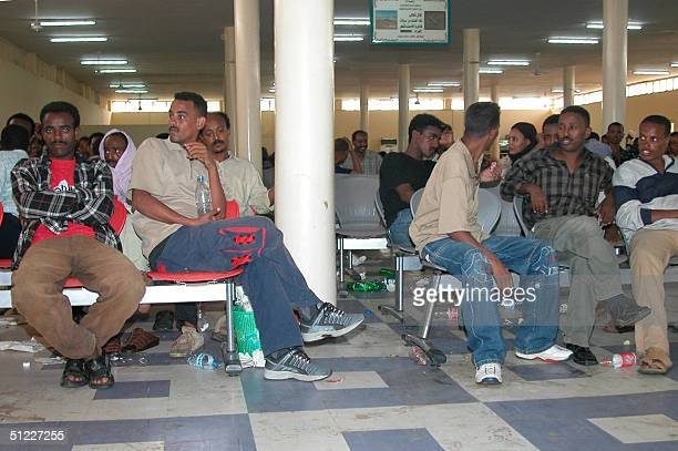 Passengers of a hijacked Libyan Air Force C1 30 plane wait at Khartoum Airport's departure hall at the end of their ordeal 27 August 2004 Four...