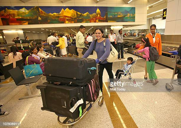Passengers of a New YorkNew Delhi Air India aircraft the first commercial flight to land at the new Terminal 3 of IGI airport after its inauguration...