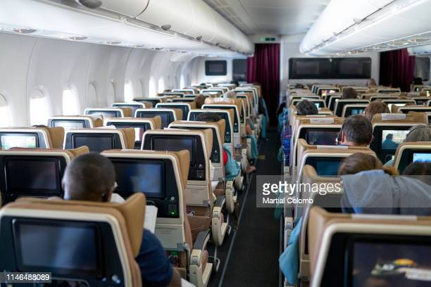passengers of an airplane - martial stock pictures, royalty-free photos & images