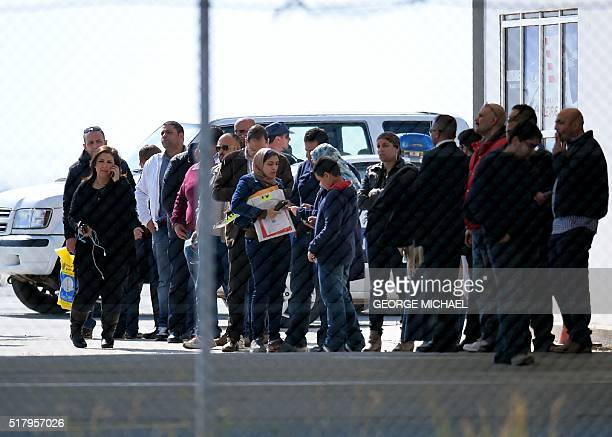 TOPSHOT Passengers of an EgyptAir Airbus A320 which was hijacked and diverted to Cyprus stand at Larnaca airport after disembarking on March 29 2016...