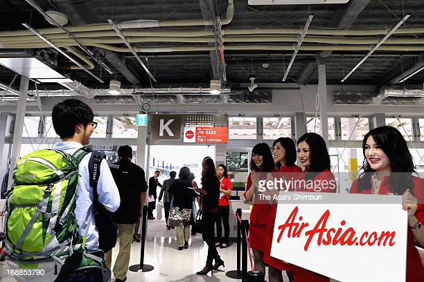 Passengers of low cost carrier AirAsia board at new designated lounge for low cost carriers at Narita International Airport on October 23 2012 in...