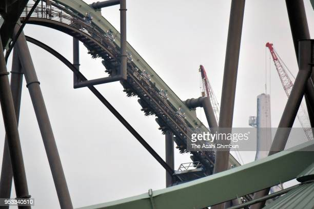 Passengers of rollercoaster Flying Dinosaur are hung in the air after the emergency stop at the Universal Studio Japan on May 1 2018 in Osaka Japan