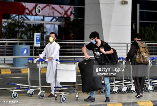Passengers of special flight for Afghanistan wait at deserted departure terminal of T3 during national lockdown to curb the spread of coronavirus at...