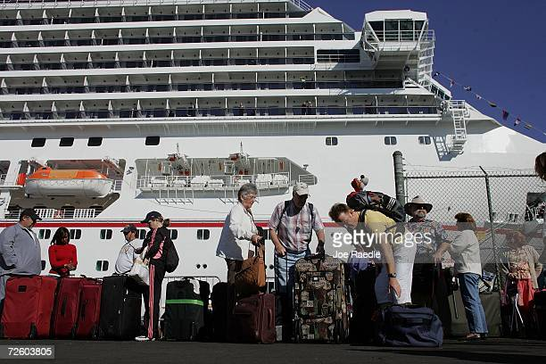 Passengers of the Carnival Liberty Cruise ship gather their luggage after they disembark from the ship at Port Everglades on November 19 2006 in Fort...