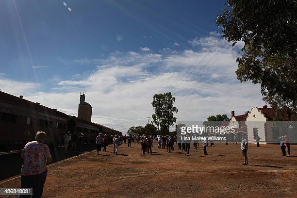 Passengers of The Ghan arrive at Quorn following a day trip on the Pichi Richi steam train through the Flinders Ranges on April 26 2014 in Port...