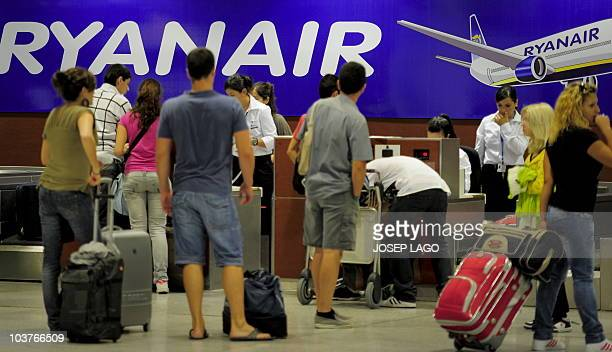 Passengers of the Irish lowcost airline Ryanair check their bags at the T2 terminal of Barcelona's airport on September 01 2010 Irish lowcost airline...