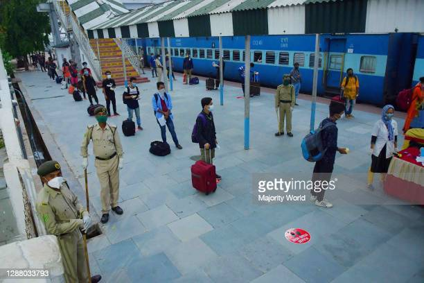 Passengers of the train, who have come to Agartala, through the first ever lockdown train, are standing in a line for screening and documentation, in...