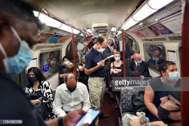 Passengers on a busy Bakerloo line train going north at rush hour with most commuters wearing face coverings on July 19, 2021 in London, United...