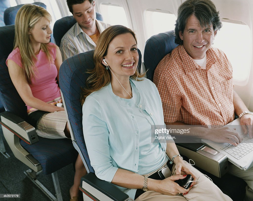 Passengers on a Plane : Stock Photo