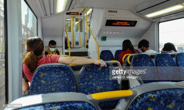 Passengers on a Sydney train service wear face masks on September 05, 2020 in Sydney, Australia. New South Wales remains on high alert as new...