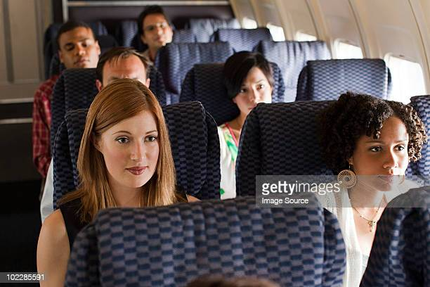 passengers on an airplane - passenger stock pictures, royalty-free photos & images