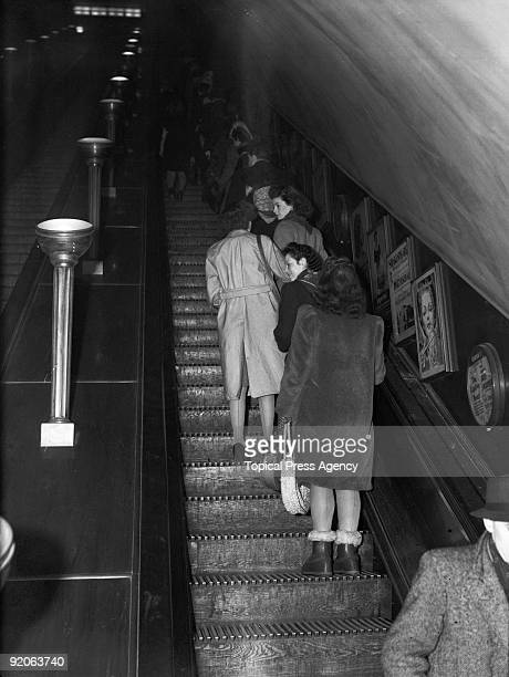 Passengers on an escalator at Leicester Square underground station in London 24th January 1947