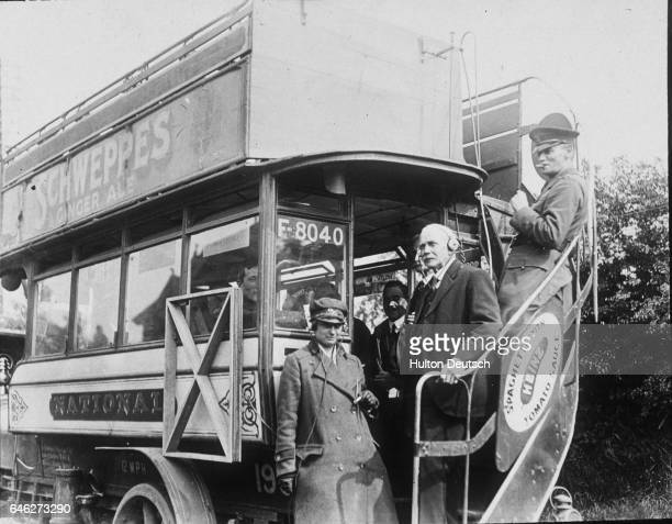 Passengers on an omnibus using radio equipment to listen to an experimental broadcast of a gramophone record from Marconi's experimental station in...