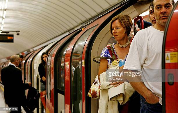 Passengers on board a busy underground train during rush hour on August 29, 2008 in London, England. Many commuters in London are using alternative...
