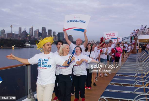 Passengers on board the Carnival Spirit cruise ship dance the conga as she arrives into Sydney Harbour on October 17 2017 in Sydney Australia To...