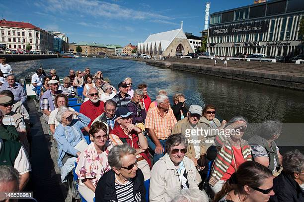 passengers on canal cruise aboard paddan sightseeing boat near feskekorka fish market (fish church). - västra götaland county stock pictures, royalty-free photos & images