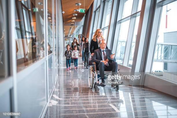 Passengers on corridor at airport terminal