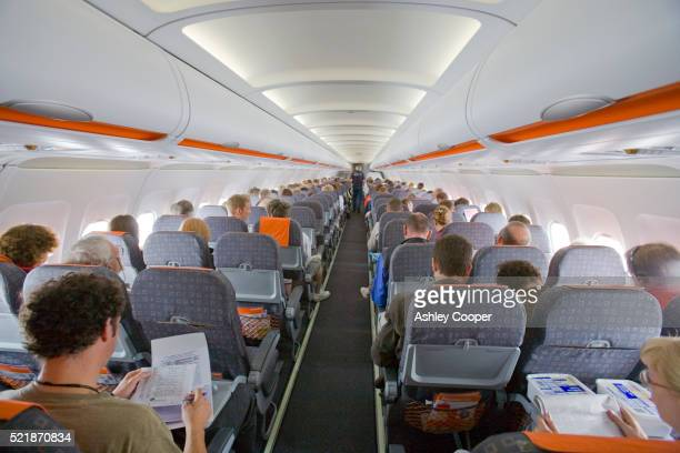 passengers on easyjet flight - easyjet stock pictures, royalty-free photos & images