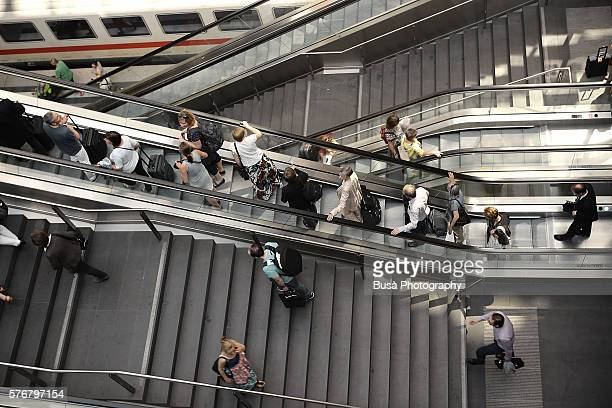 Passengers on escalators and stairs inside Berlin Central Station (Hauptbahnhof), the main station of Berlin, Germany