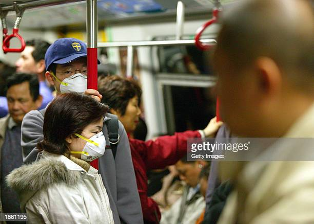 Passengers on Hong Kong's subway wear protective masks to try to prevent any chance of catching the severe acute respiratory syndrome , the mystery...