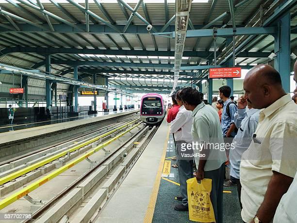 Passengers on Metro station platform, Bangalore, India