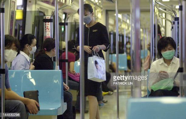 Passengers on one of Taipei's subway trains wear masks to prevent the spread of the deadly Severe Acute Respiratory Syndrome 11 May 2003 As part of...
