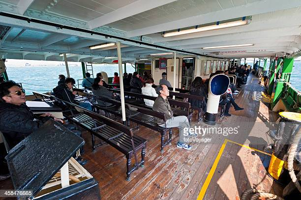 passengers on star ferry hong kong harbour - star ferry stock photos and pictures