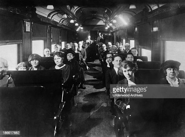 Passengers on the Chicago Alton Railroad are entertained by an experimental showing of the movie The Flame of Life starring Priscilla Dean on the...