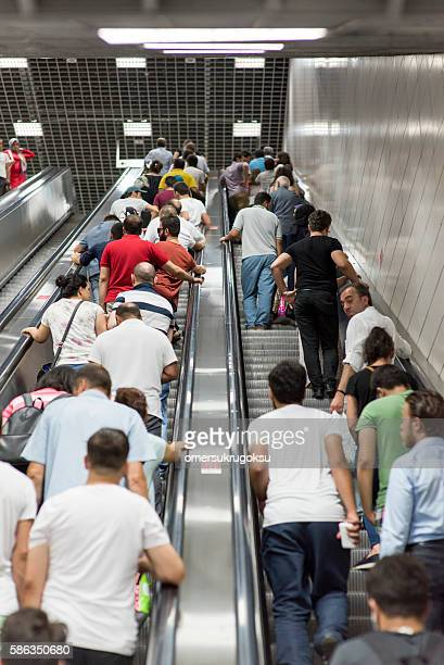 Passengers on the escalator in the subway station