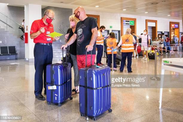 Passengers on the first flight from the UK since the country included the Balearics on the COVID-19 green travel risk list, at Menorca Airport, on 1...