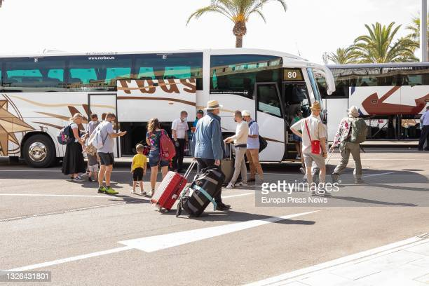 Passengers on the first flight from the UK since the country placed the Balearics on the COVID-19 green travel risk list leave Menorca Airport on 1...