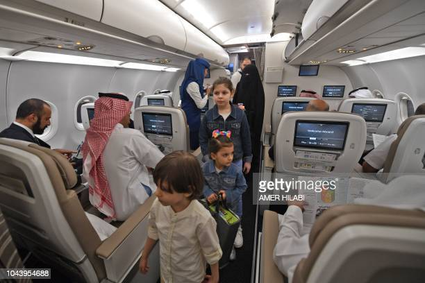 Passengers on the first Saudi Airlines direct flight from Jeddah to the Iraqi city of Arbil visit the aircraft during their trip on October 1 2018
