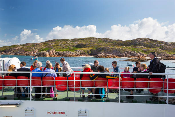 Passengers on the Iona ferry at Fionnphort Isle of Mull, Scotland, UK.