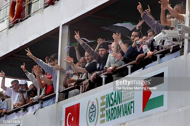 Passengers on the Mavi Marmara greet the passengers of the MV Amal after mechanical problems resulted in MV Amal passengers being relocated to the...